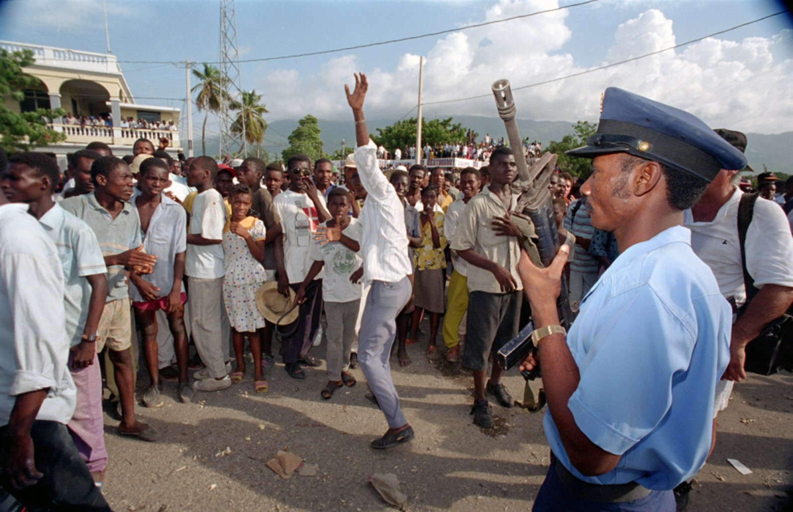 Protests in Haiti against the military regime that seized power in a coup in 1991. This photo was taken in 1994, as the US intervened to help reinstate the democratically elected president. (Credit Tim Chapman, Courtesy History Miami)