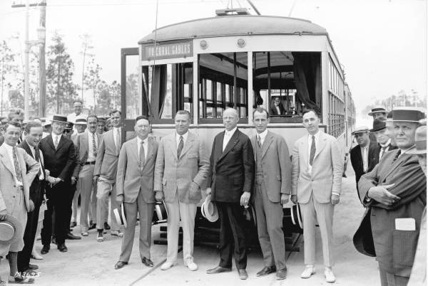 "In 1925, the new trolley made its first run from downtown Miami. F.W. Webster, George E. Merrick, Mayor Edward ""Doc"" Dammers, Jack Baldwin and Telfair Knight proudly stand before a fleet of trolleys. (Courtesy of Coral Gables Historical Resources)"