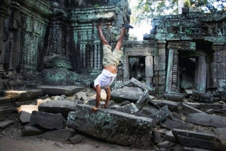 Diego doing a handstand in Cambodia. (Photo courtesy of Diego Orlandini)