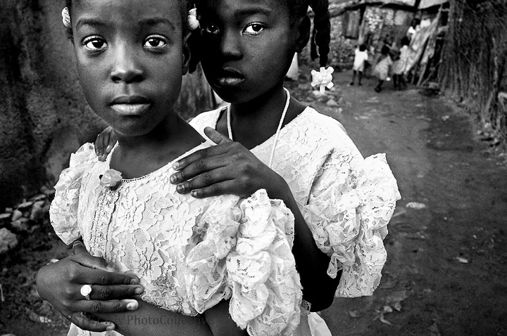 Port-de-Paix, Haiti. Young Haitian sisters dressed in their Sunday's best walk home from Sunday mass on the dirt paved road of Port-de-Paix, Haiti. (Photo courtesy of Carl Juste)