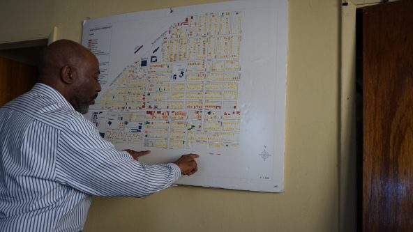 Jihad Rashid points out the Marler Avenue wall in Coconut Grove on a map that hangs in his offices in the CDC buildings.