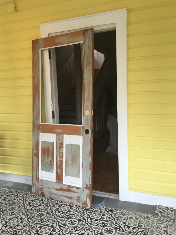 The mahogany front door of the River Inn, in the process of being stripped of white paint (Courtesy of River Inn Miami)