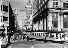 Pedestrians, traffic and three streetcars, looking north on N.E. 1st Avenue from the Flagler Street intersection. (Courtesy of HistoryMiami)