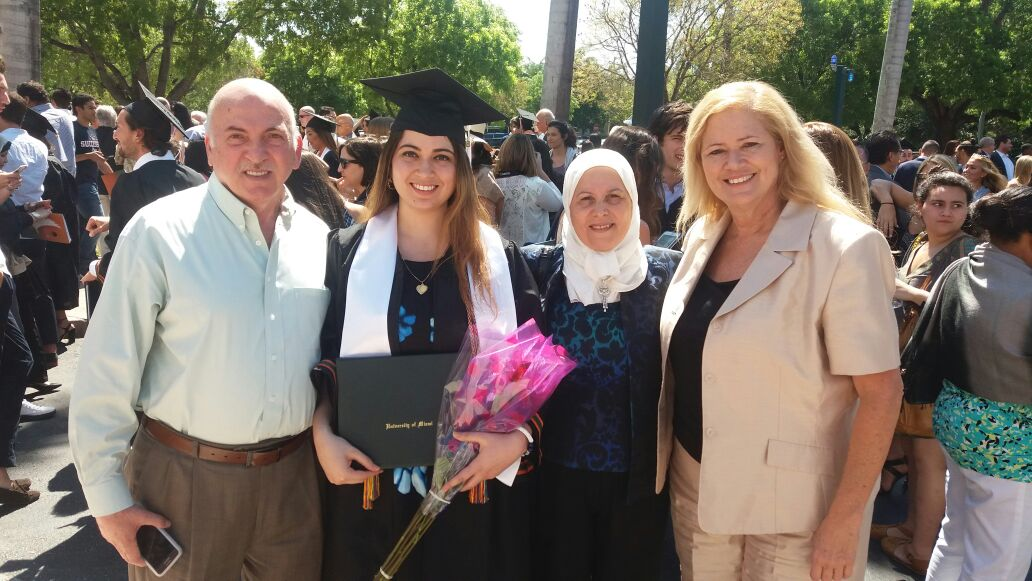Jasmin with her father, aunt, and mother the day she graduated from UM.