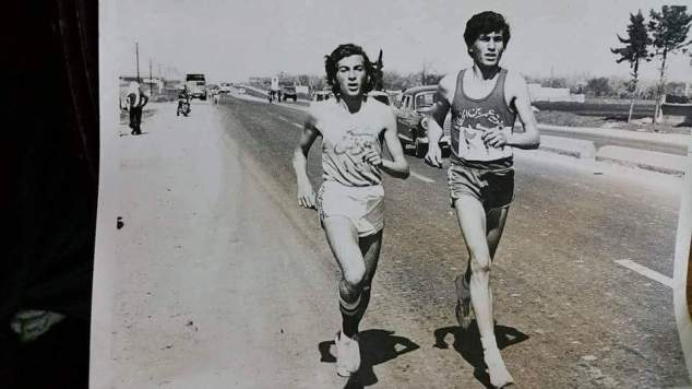 Jasmin's father, on the left, runs in a track meet in Homs as a teenager