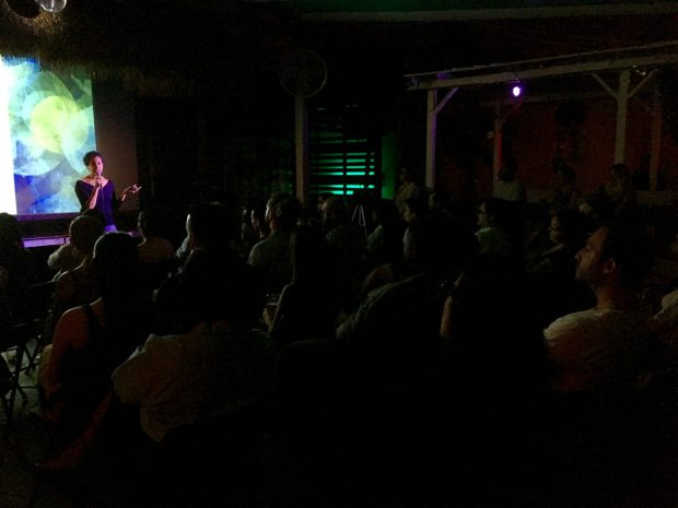 A speaker at Nerd Nite, discussing trust. (Credit: Roshan Nebhrajani/The New Tropic)
