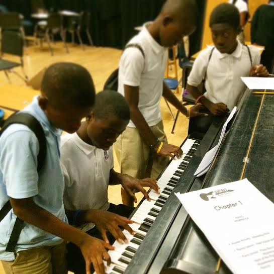 Students learn piano with a Guitars over Guns workbook. (Photo courtesy of Chad Bernstein)