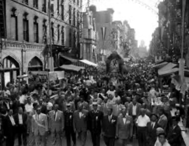 "Circa 1940s - at its peak, New York's Little Italy hosted the ""Festa di San Gennaro"", the largest and most elaborate Italian Street feast in all of the United States. It ran for almost 15 city blocks in length, and was 4 blocks wide..."