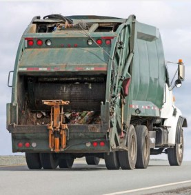 Garbage truck compactor