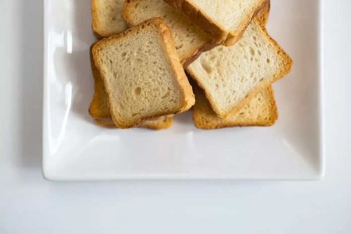 Slices of white toast on  a white plate