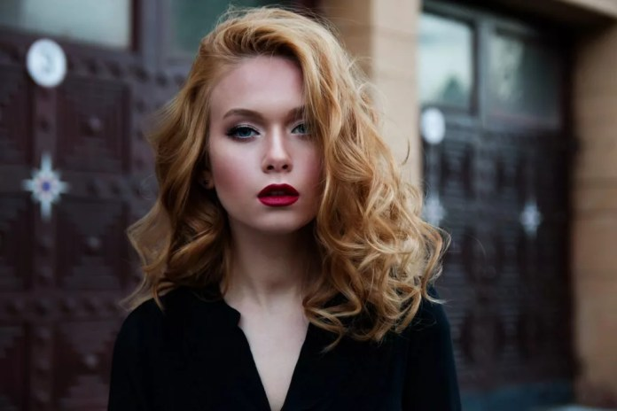 Blonde woman wearing red lipstick