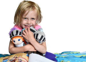 Girl with book and dolls cropped