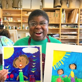 Aba with her Michelle Obama paintings