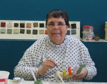 Leona Clawson in the ceramics studio