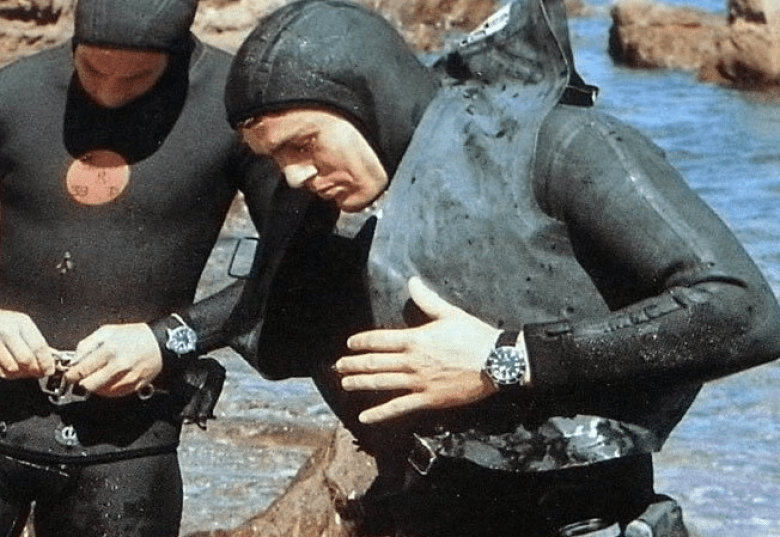 Divers wearing dive watches and wet suits
