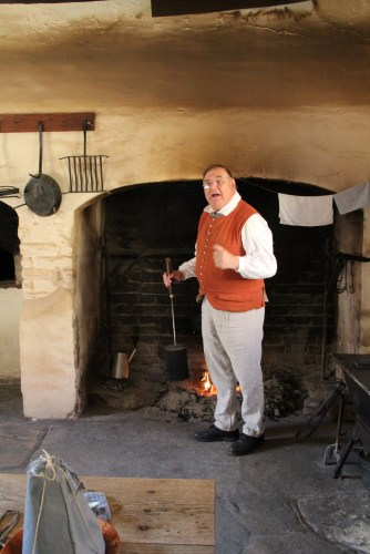 A reenactor demonstrates coffee-roasting.