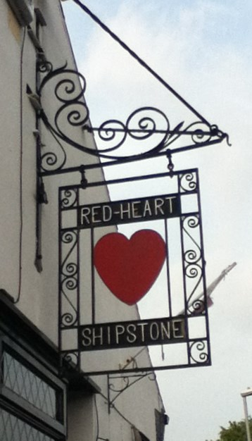 The Red Heart Shipstones Sign