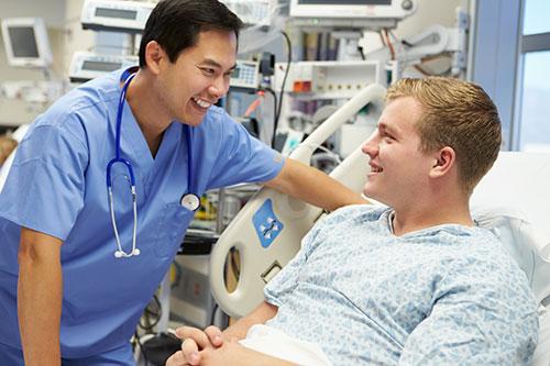 nurse with patient bedside