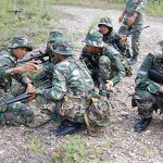 Khairy in the army, huddling with the platoon