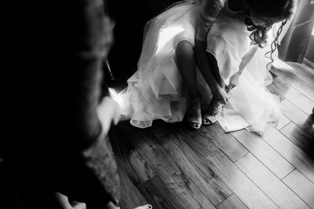 bride putting shoes on west virginia wedding