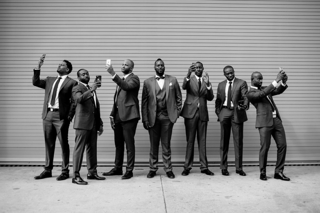 groomsmen taking selfies portrait