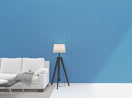 A white couch against bright blue shiplap, the ideal set up for online OCD treatment with Lauren Rosen, LMFT.