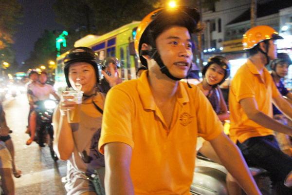 Vietnam Ho Chi Minh Vespa Jac and beer Michelle