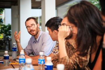 Yale-NUS professors engage in intense discussion.