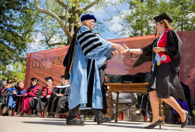 Iulia receiving her diploma at Grinnell College. Picture credit to John Brady Photography.