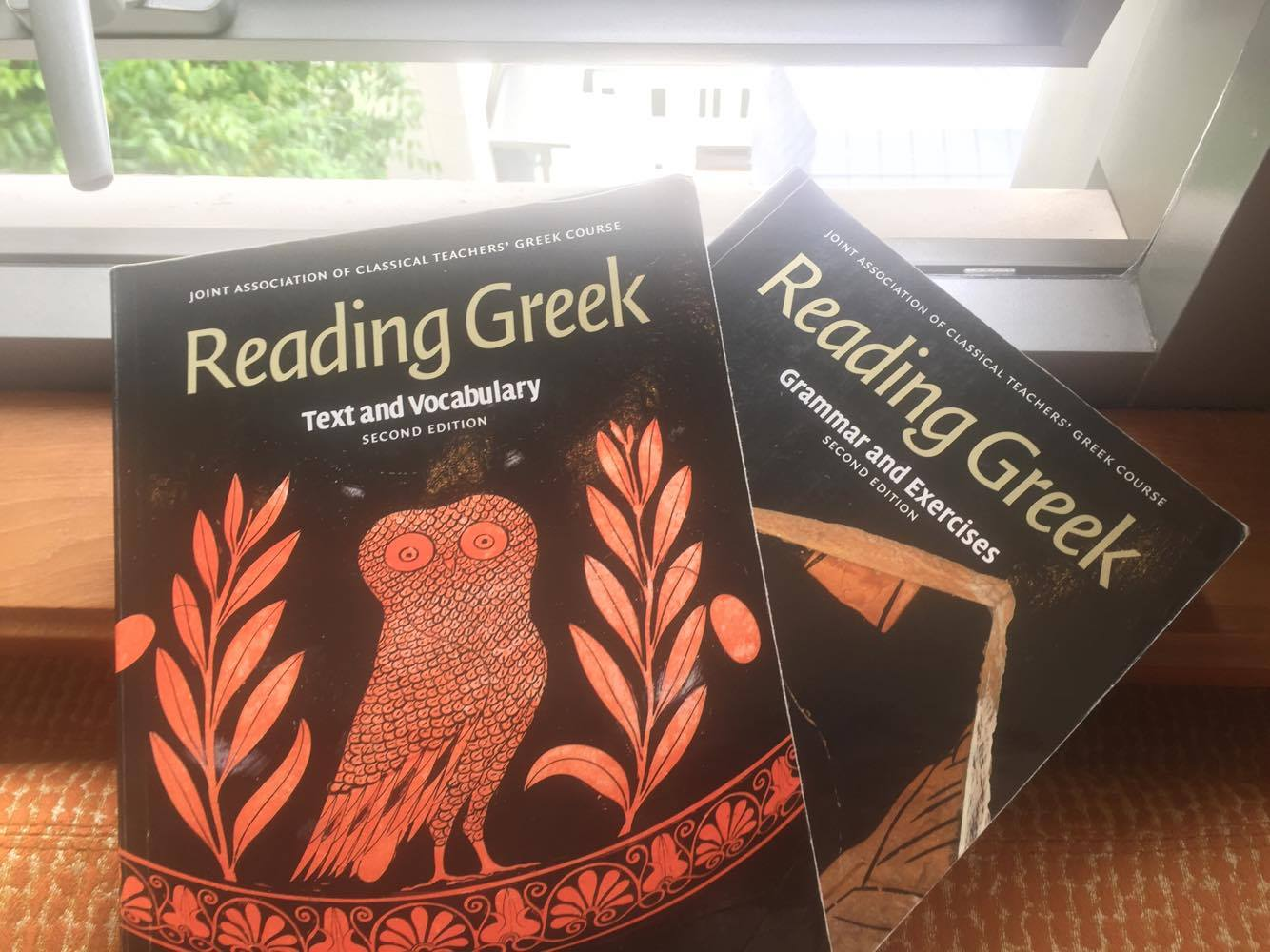 Two text books from Yale-NUS'S Ancient Greek Course.
