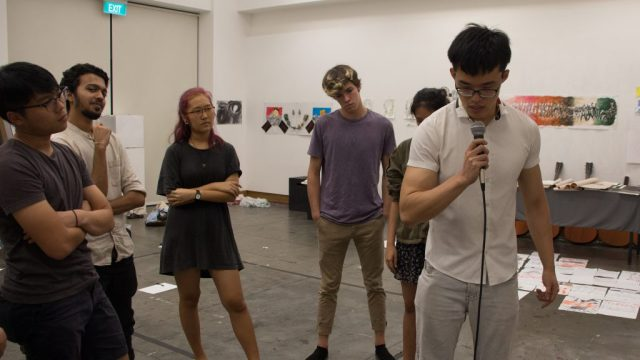 See Wern Hao' 20 recording his voice during an exposure session, coordinated by Jay Ong' 21, to the loop machine,