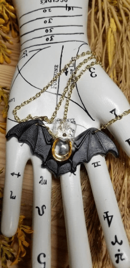 resin bat necklace with horseshoe