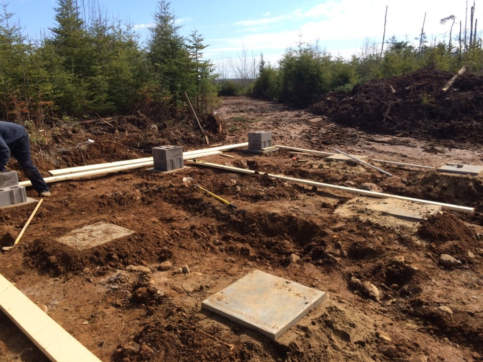 Footing placement for cabin foundations