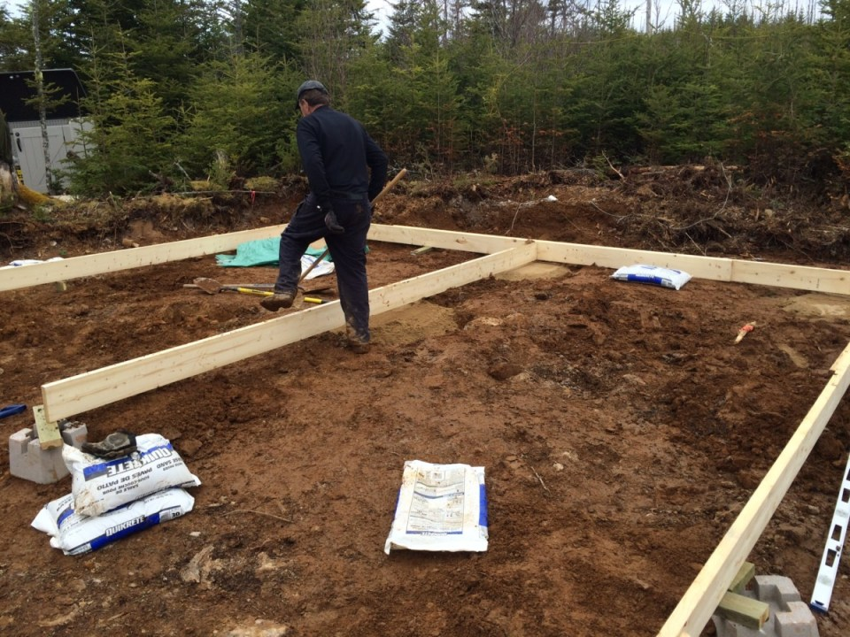 Laying out the of grid cabin foundation