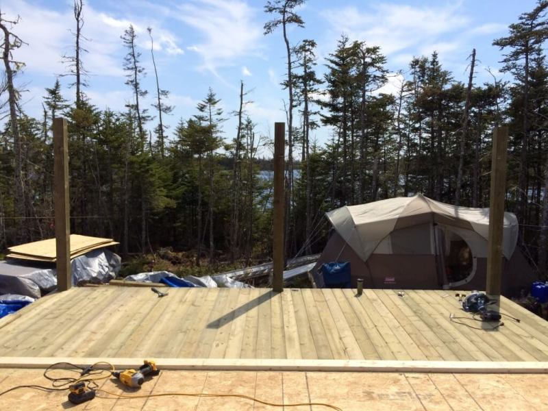 Cabin front deck pressure treated decking install complete 2