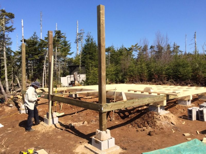 cabin front deck with three posts installed