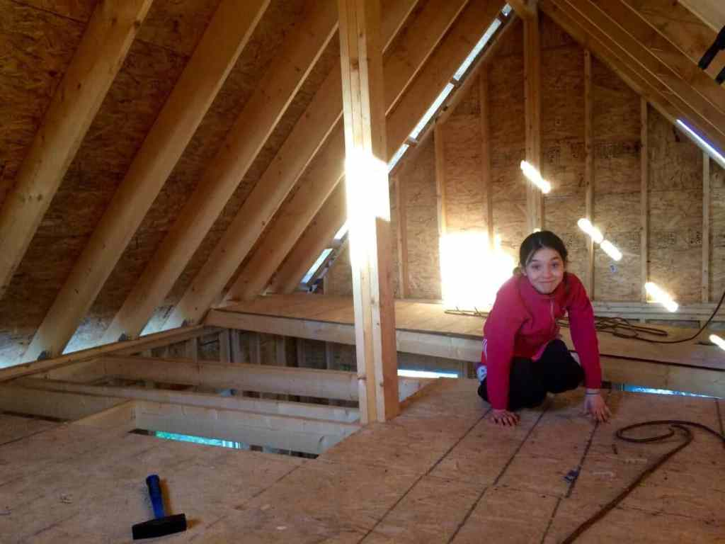 Clara-Dupuis-in-the-loft-of-The-Off-Grid-Cabin-1