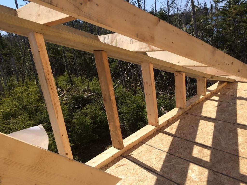 The-Off-Grid-Cabin-Roof-Rake-Ladder-Framing-Over-The-East-Deck-Complete