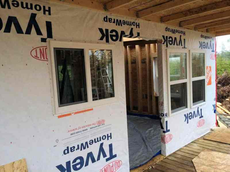 The-Off-Grid-Cabin-Front-Living-room-and-kitchen-windows-installed