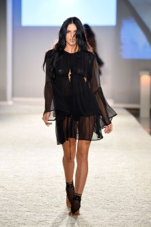 MIAMI BEACH, FL - JULY 16: A model walks the runway at the INDAH Clothing Presents Casa INDAH at SwimMiami - Runway at W South Beach on July 16, 2016 in Miami Beach, Florida. (Photo by Frazer Harrison/Getty Images for INDAH)