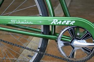 girl on a green bike