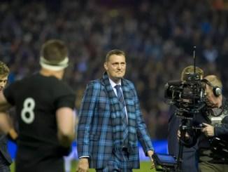 Scotland legend Doddie Weir delivers the match ball before Scotland's Autumn Test clash against New Zealand