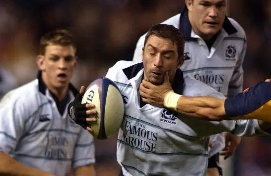 New Scotland Under-20s head coach Bryan Redpath in action during his playing days, against Romania in 2002, with Nikki Walker , now his assistant in the age-grade set-up, in the background.