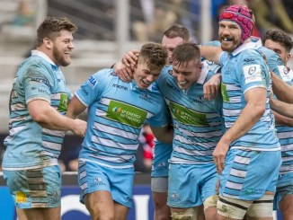 Glasgow Warriors players celebrate Huw Jones' try against Lyon.