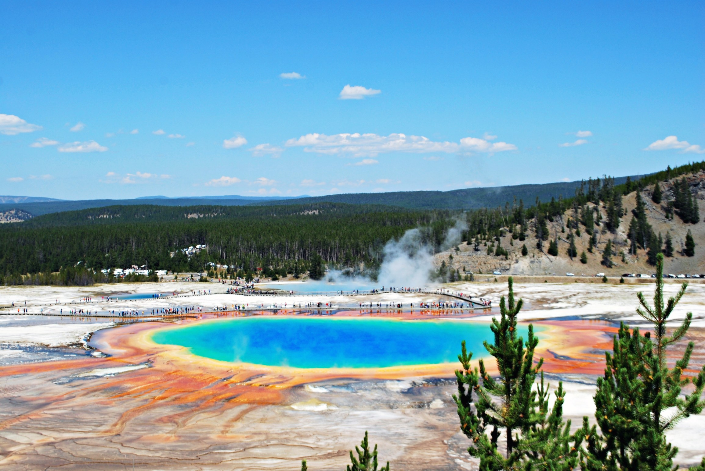 This Yellowstone National Park vacation itinerary creates the ultimate bucket list for your next adventure! Learn the best things to do in Yellowstone including visit Mammoth Hot Springs, the Grand Canyon of Yellowstone, and Old Faithful. Learn what lodges and camping sites that are perfect for your road trip during summer, spring, or fall, and the best packing tips, hiking destinations, and travel hacks you will need. Read now to learn about your next USA travel adventure! #yellowstone