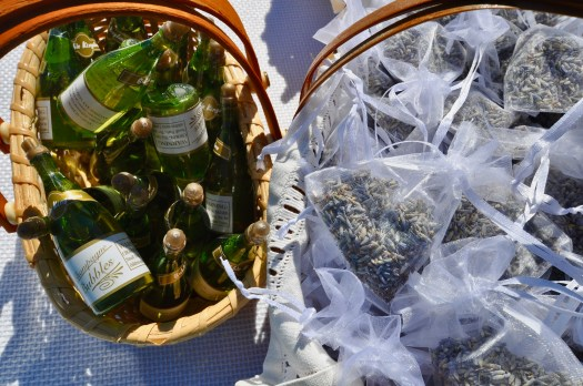 Miniature champagne bottles filled with soap bubbles and sachets of lavender in separate baskets.