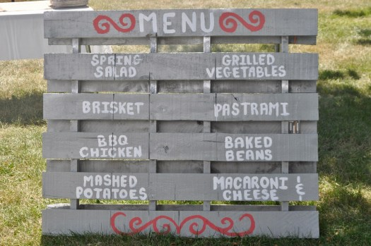 A food menu painted on a pallet.