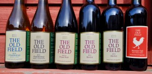 six bottles of wine, The Old Field Vineyard, Mostly Steel Chardonnay, Barrel Fermented Chardonnay, Pinot Noir, Merlot, Rooster Tail