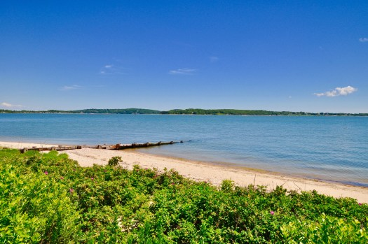 Beach with water and Shelter Island in back