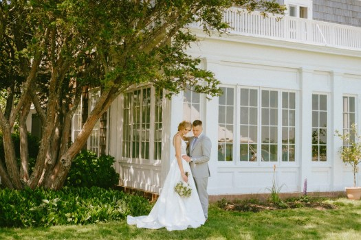 Wedding couple in front of the owners house.